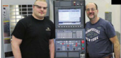 Tyler Zerbe (left), one of two students from R.G. Drage working at Quadra Tooling and Automation during his senior year, poses with Mike Alessandro, a Quadra employee who has helped to mentor him.